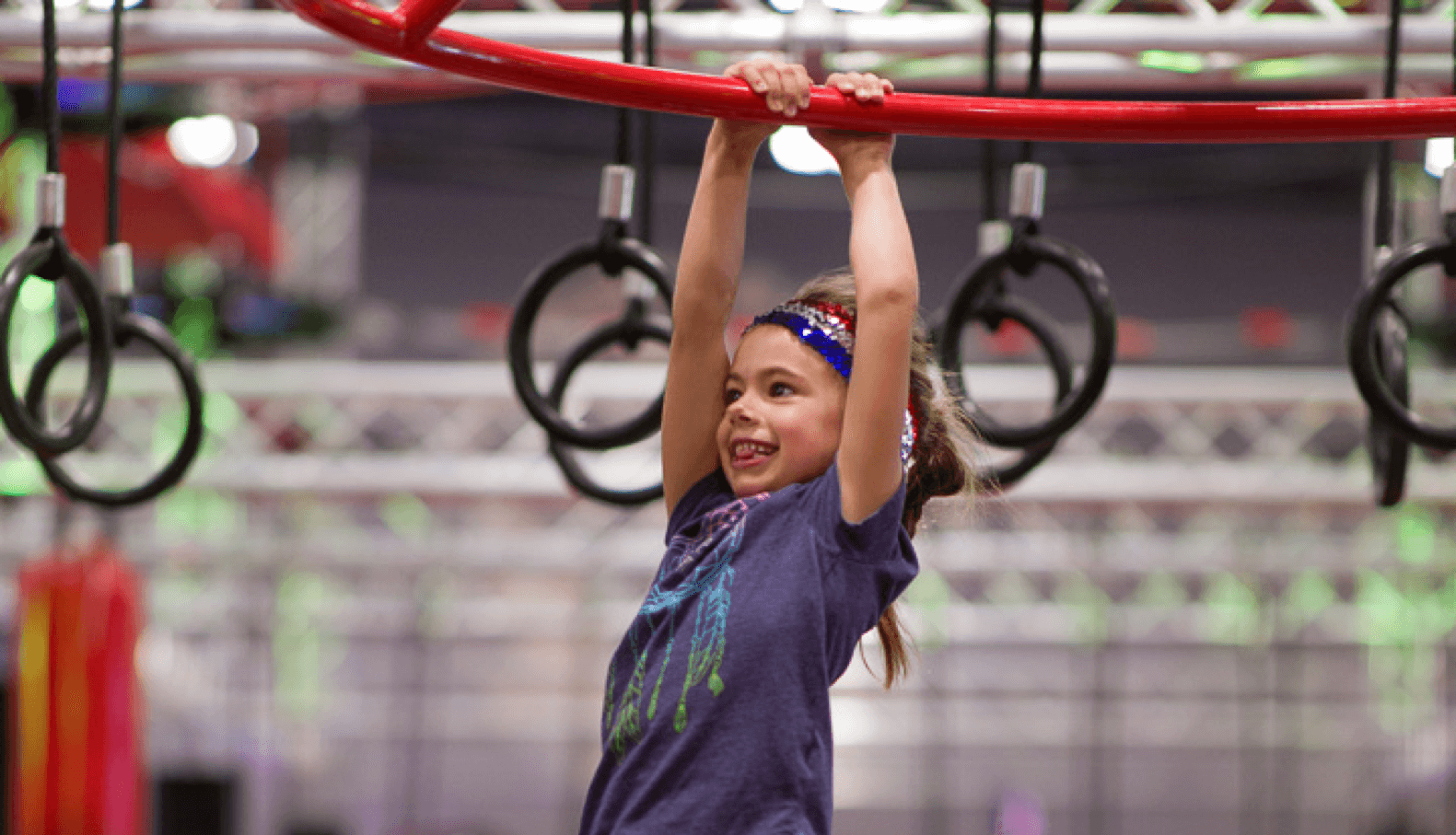 girl playing on the monkey bars