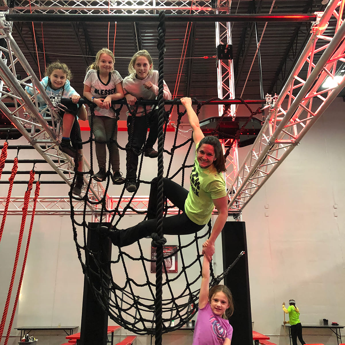 A group of girls on a rope obstacle