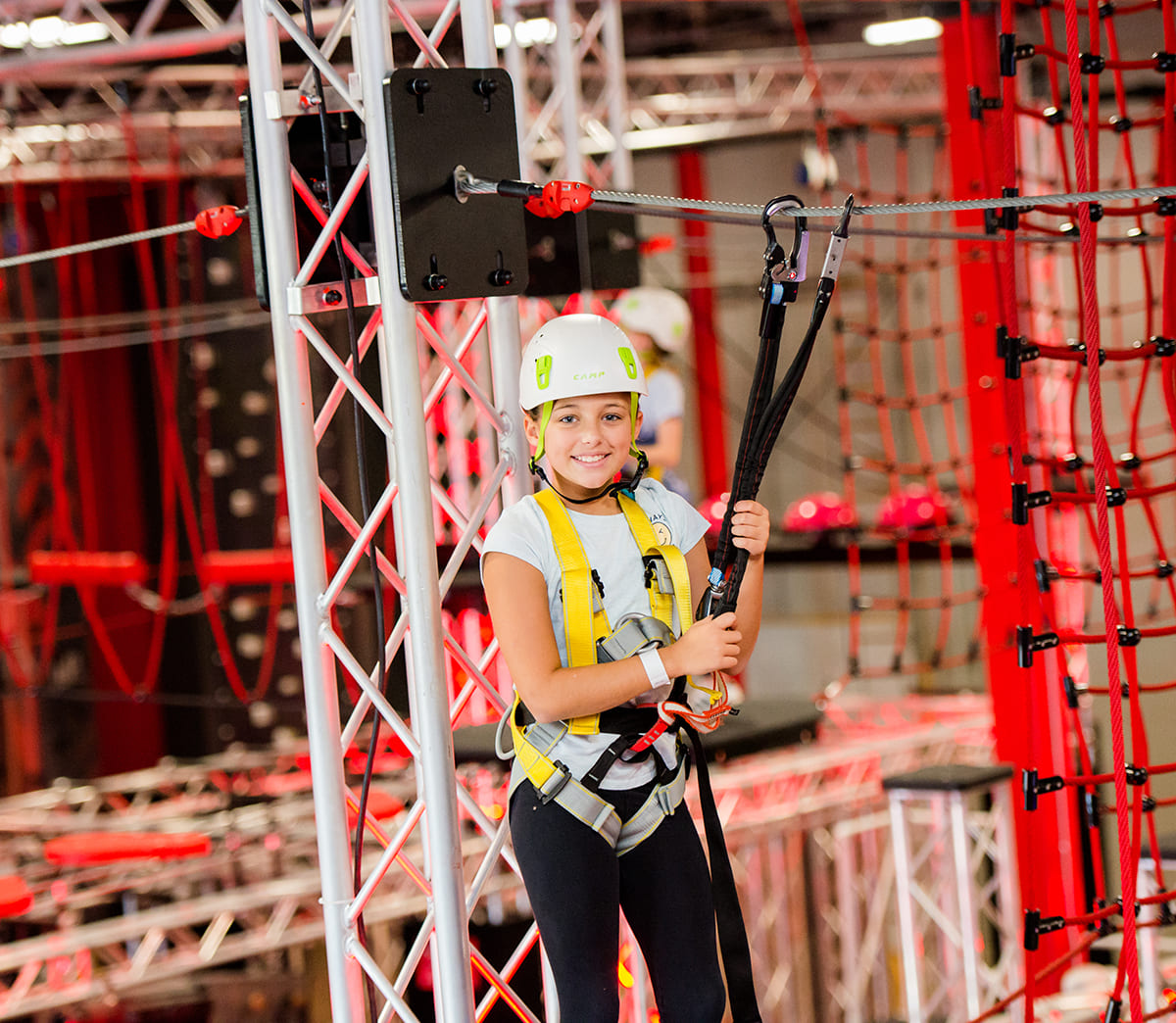 A young girl on an Adrenaline Monkey obstacle